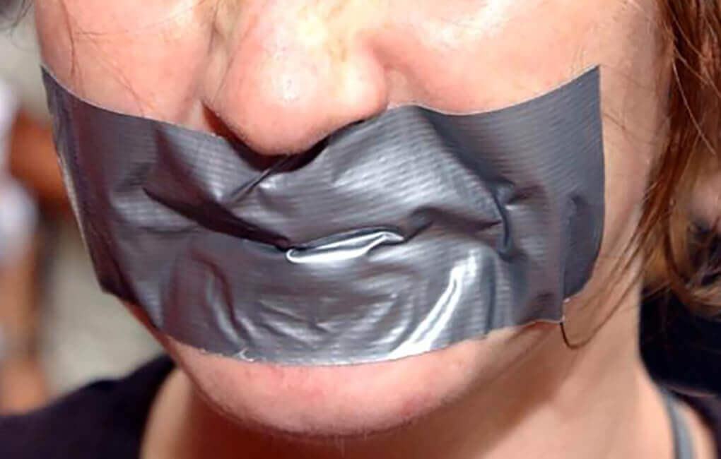 woman puts duct tape over her mouth so she won't cheat on her diet. She has stockholm syndrome from being lied to by the Diet Industry