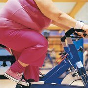 plus size woman on stationery bike