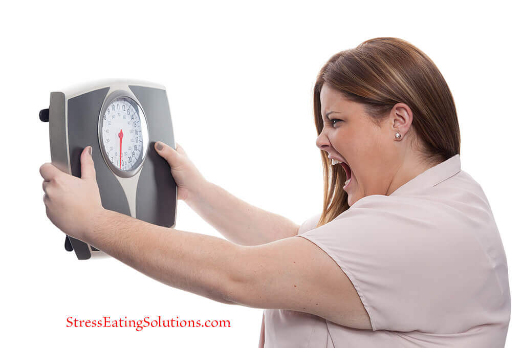 woman angry at scale for weight gain