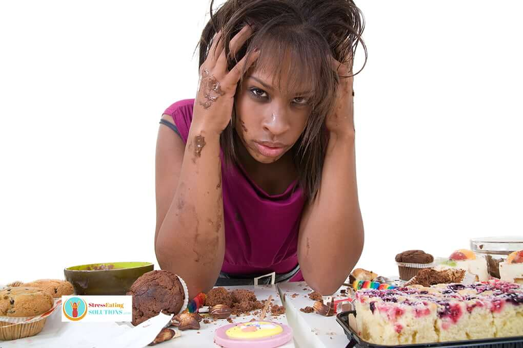 Women who has just completed Stress Eating eating sweets and carbs -