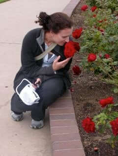 young woman mindfully smell the roses