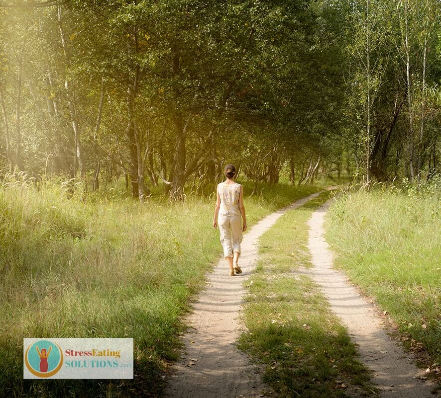 a woman walking mindfully in nature