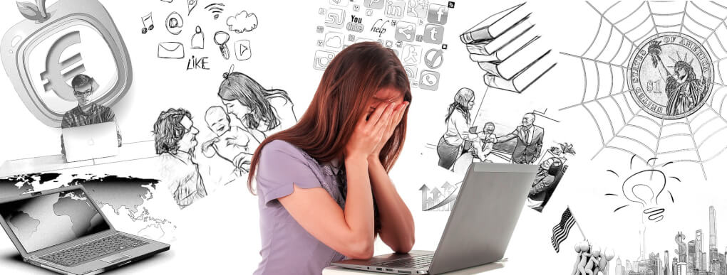 stressed from multi-tasking woman holds her hands in front of her face